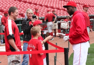 Here's Ed Hartman from Furniture Fair fame signing an autograph for Brandon Phillips
