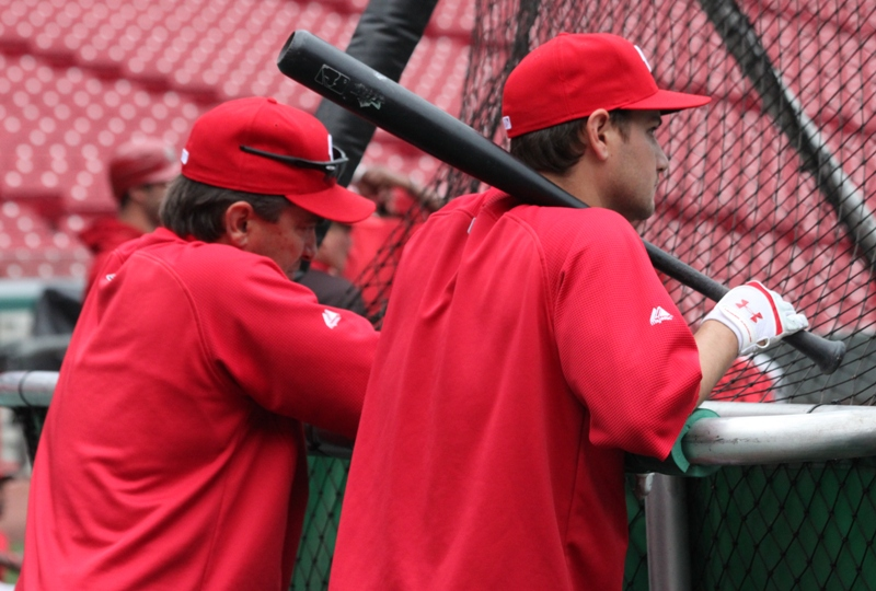 "Reds hitting coach Brook Jacoby talks with Paul Janish about changing the pronunciation of his last name to ""Yuh-kobey."""