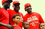 Brandon Phillips and Dusty Baker pose with members of the Billings Mustangs, whose season started today