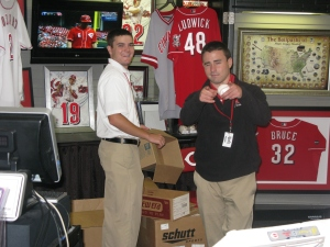 Ryne and Jon with game used merchandise