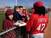 Johnny Cueto signing autographs for fans