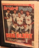When I was on the ground crew in '99, I picked up this copy of Baseball Weekly that featured the Reds bullpen (and Jack McKeon). I asked all the pitchers (and Jack) to sign it in silver marker. It hangs in my office today.