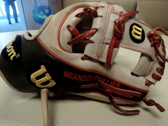 The glove Phillips used during his Gold Glove 2013 season