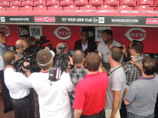 Iglesias and his agent meet with the media after signing with the Reds in June 2014