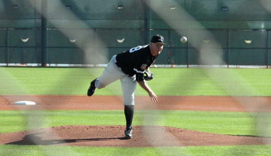 Former Red Mat Latos fires a pitch for the White Sox in this morning's B-Game in Goodyear