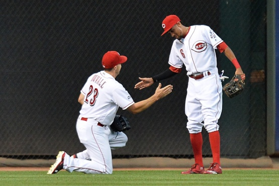 CINCINNATI, OH - JULY 16: Billy Hamilton #6 of the Cincinnati Reds congratulates Adam Duvall #23 of the Cincinnati Reds after Duvall made a running catch on a fly ball in the fifth inning against the Milwaukee Brewers at Great American Ball Park on July16, 2016 in Cincinnati, Ohio. Milwaukee defeated Cincinnati 9-1. (Photo by Jamie Sabau/Getty Images)