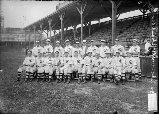 Group portrait of National League's Chicago Cubs baseball team players, World Champions 1908, posing for a photograph on the field at West Side Grounds, Chicago, Illinois, 1908. Heinie Zimmerman, John Kling, Johnny Evers and Frank Schulte are included in this image. The coach is standing in the middle of the back row of players. A section of spectators sitting in the grandstands are visible in the background. From the Chicago Daily News collection. (Photo by Chicago History Museum/Getty Images)
