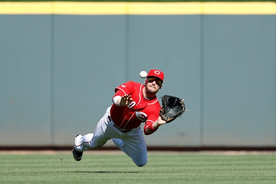 CINCINNATI, OH - JUNE 11: Tyler Holt #40 of the Cincinnati Reds makes a diving catch against the Oakland Athletics in the sixth inning of the game at Great American Ball Park on June 11, 2016 in Cincinnati, Ohio. (Photo by Joe Robbins/Getty Images)