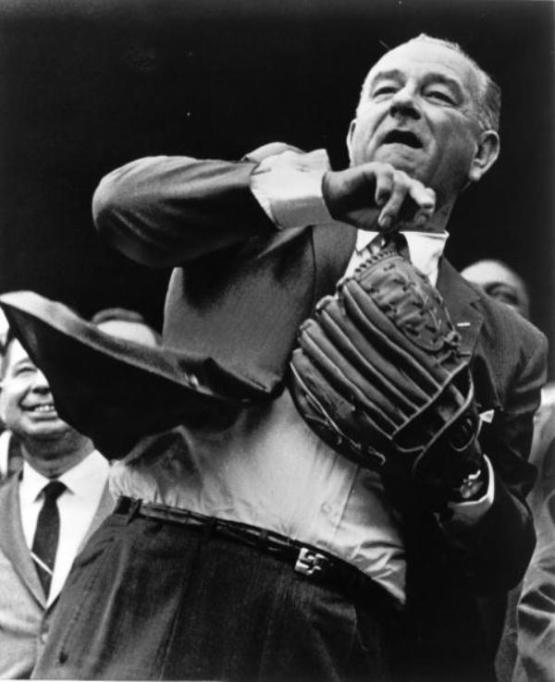 President Lyndon Johnson with coat tails flying officially opens the American League season. (Photo by Rogers Photo Archive/Getty Images)