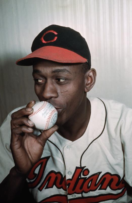Legendary pitcher Leroy Paige, known as Satchel Paige, kisses a ball of the sport that made him famous. (Photo credit: Bettmann / Contributor Getty)