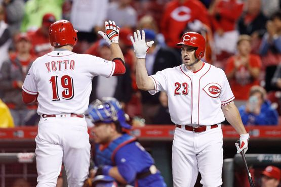 CINCINNATI, OH - SEPTEMBER 30: Joey Votto #19 of the Cincinnati Reds celebrates with Adam Duvall #23 after hitting a two-run home run in the ninth inning against the Chicago Cubs at Great American Ball Park on September 30, 2016 in Cincinnati, Ohio. The Cubs defeated the Reds 7-3. (Photo by Joe Robbins/Getty Images)